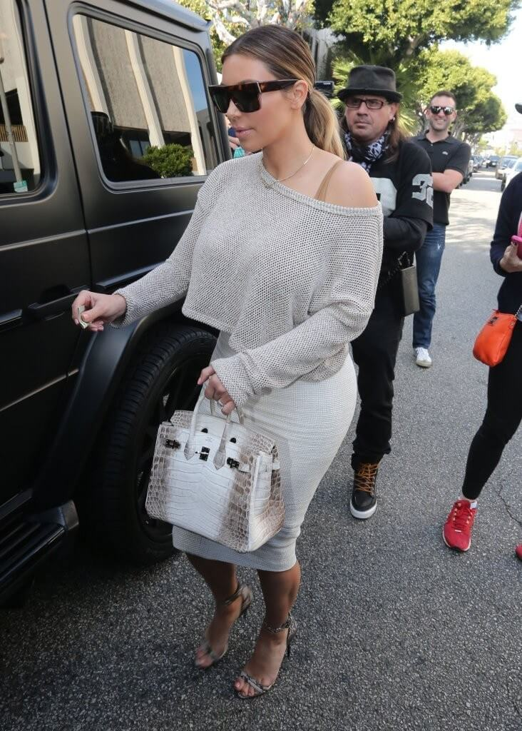Kim Kardashian carries Hermes crocodile birkin  - Why The Hermes Replica Handbags Is So Expensive (When It Is A Simple Bag to Make)