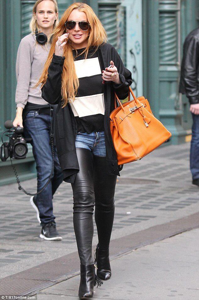 Lindsay Lohan Hermes Birkin bag orange - 10 Celebrities Who Wear Hermes Birkin Bags