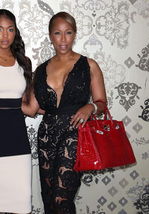 Maejorie Harvey wears red crocodile hermes birkin - 10 Celebrities Who Wear Hermes Birkin Bags